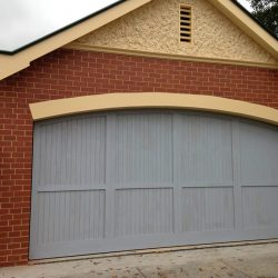 Counterweight-curved-top-cedar-with-cedar-moulds-Garage-Door