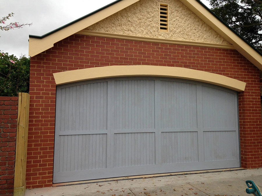 Counterweight-curved-top-cedar-with-cedar-moulds-Garage-Door