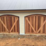 Curved-top-cedar-counterweight-Garage-Door