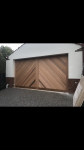 Tilt Door Clad With Cedar In Herringbone Style