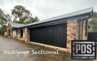 Frame only designer sectional garage door, clad by builder with charred cedar #customsectionaldoor #designergaragedoors