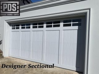 Designer sectional garage door finished with cedar and mouldings #hamptonsgaragedoors #custommadegaragedoors