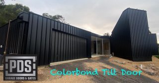 Tilt door finished with Colorbond standing seam cladding #tiltgaragedoor #colorbondtiltdoor