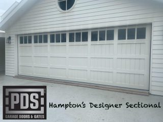 Another example of the classic Hampton's style designer sectional garage door #custommadegaragedoor #hamptonsstylegaragedoor