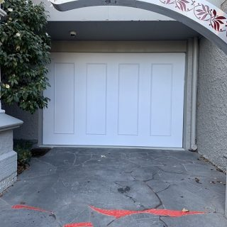 Tilt garage door finished with marine grade scarf ply and rectangle mouldings #tiltgaragedoor #customgaragedoors #garagedoorsmelbourne