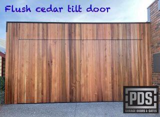 Castellation cedar flush tilt door. We custom make garage doors to suit the facade of your house, give us a call today #flushgaragedoor #custommadegaragedoormelbourne