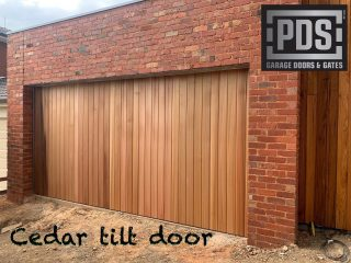 Tilt door finished with vertical cedar #customgaragedoorsmelbourne #tiltdoor