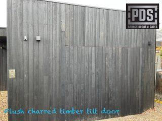 Flush charred timber tilt door #flushgaragedoor #custommadegaragedoor #tiltgaragedoormelbourne