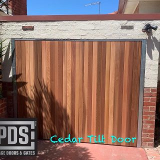 Cedar tilt door, we custom make garage doors to suit the style of your home #custommadegaragedoors #tiltgaragedoors