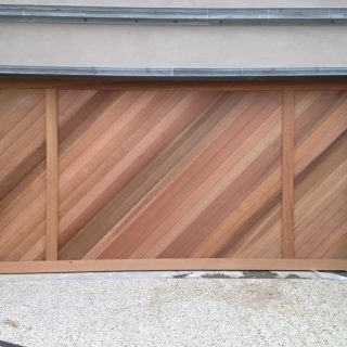 Tilt door finished with diagonal cedar #customgaragedoors #garagedoorsmelbourne