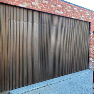 Flush counter weight garage door finished with bio wood #counterweightgaragedoor #flushgaragedoor