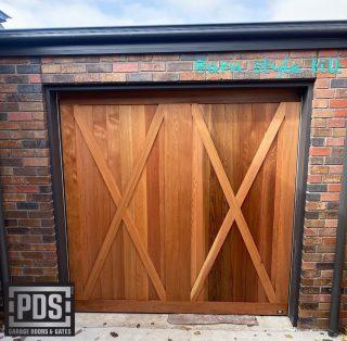 Barn style tilt door. We custom make garage doors to suit your style #barnstylegaragedoor #customgaragedoorsmelbourne