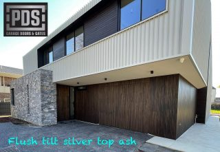 Tilt door, flush install finished in silver top ash #custommadetiltdoors #customgaragedoor